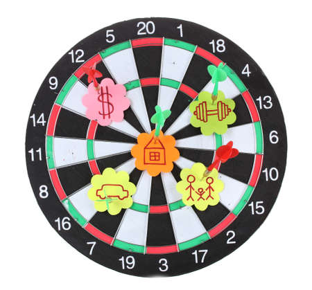 Darts with stickers depicting the life values isolated on white. The darts hit the target. photo