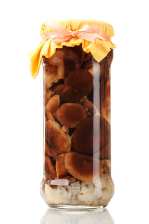 delicious marinated mushrooms in the glass jar isolated on white photo