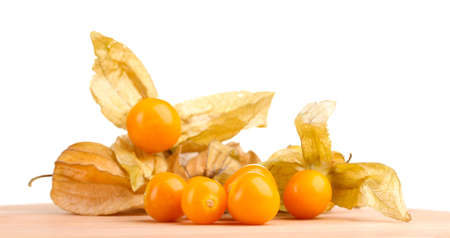 Physalis heap on wooden table on white background photo