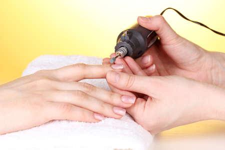 acrylic nails: Manicure process in salon