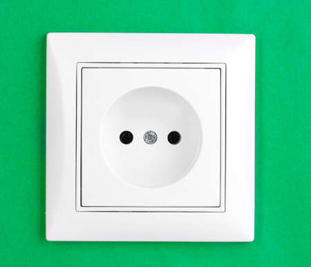 White electric socket on the wall photo