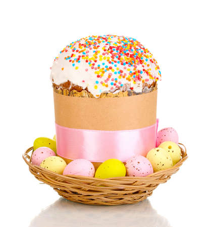 Beautiful Easter cake in basket with eggs isolated on white Stock Photo - 13370106