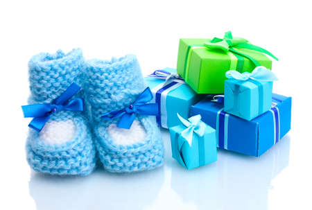 beautiful gifts and babys bootees isolated on white photo