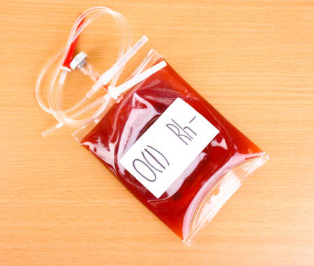 Bag of blood and infusion on wooden background Stock Photo - 13370204