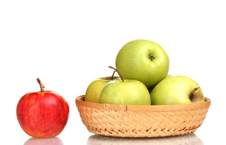 juicy green apples in the basket and red apple isolated on white photo
