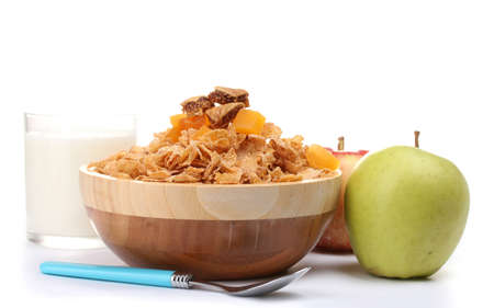 tasty cornflakes in wooden bowl, apples and glass of milk isolated on white Stock Photo - 13437796