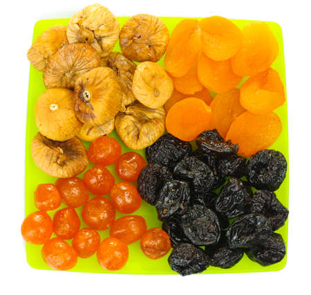 delicious dried fruits on plate isolated on white Stock Photo - 13437801