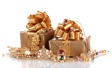 Various gold jewellery and gifts isolated on white Stock Photo - 13437942