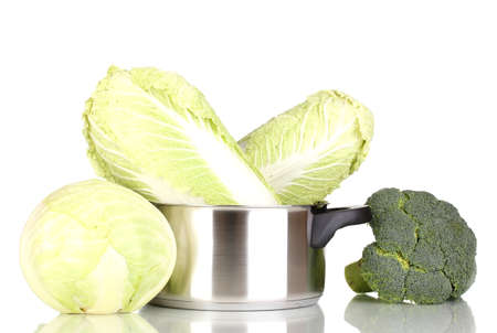Saucepan with cabbages and broccoli isolated on white photo