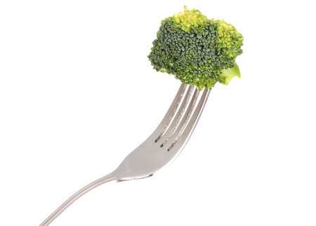Fresh broccoli on fork isolated on white photo