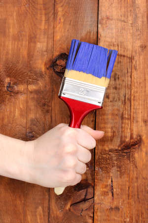 Painting wooden fence with yellow paint Stock Photo - 13438149