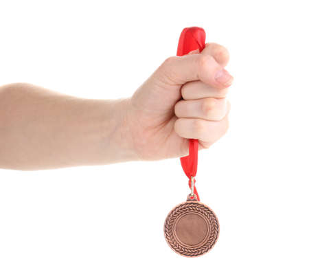 Bronze medal in hand isolated on white photo