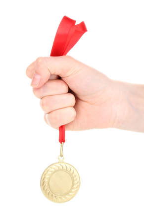 Gold medal in hand isolated on white photo