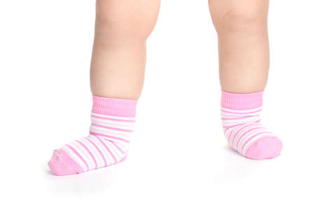Baby feet fin socks isolated on white photo