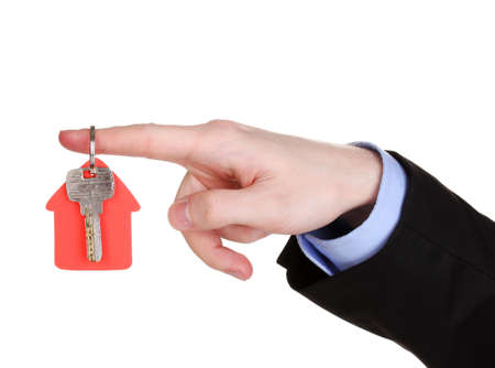 Key with house-shaped charm in hand isolated on white Stock Photo - 13437715