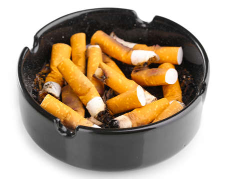 Cigarette butts in ashtray isolateed on white photo