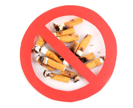 Cigarette butts with prohibition sign isolateed on white Stock Photo - 13437799