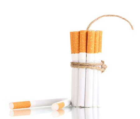 Cigarettes tied with rope and wick isolateed on white photo