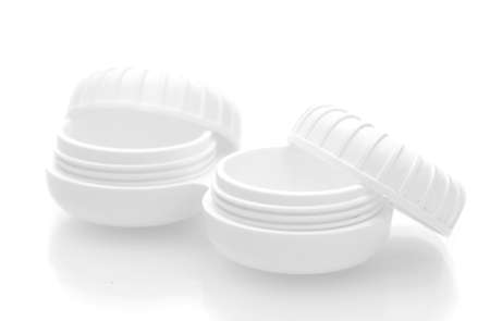 containers for contact lenses isolated on white photo