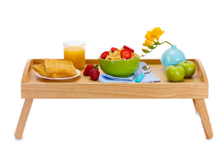light breakfast on wooden tray isolated on white Stock Photo - 13437668
