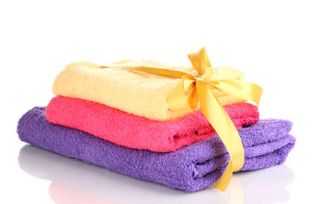 Colorful towels with ribbon isolated on white photo