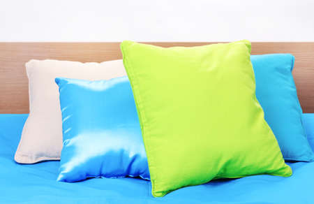 bright pillows on bed on white background Stock Photo - 13437943