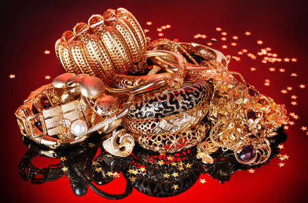 Beautiful golden jewelry on red background Stock Photo - 13438231