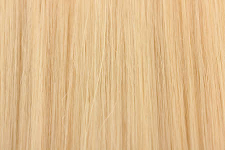 Shiny blond hair close-up photo
