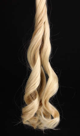 Curly blond hair isolated on black Stock Photo - 13438861