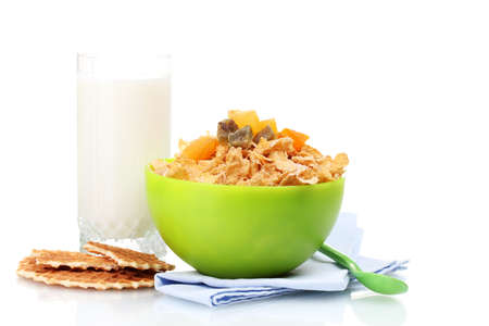 tasty cornflakes in green bowl and glass of milk isolated on white photo
