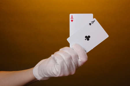 Cards in hand on brown background photo
