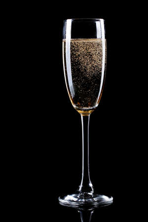 glass of champagne on black background photo