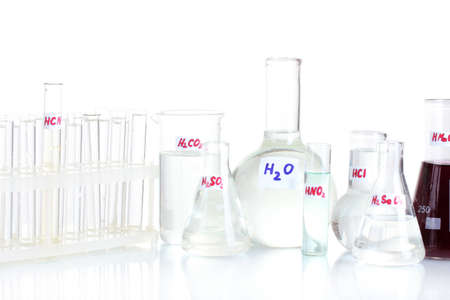 Test-tubes with various acids isolated on white Stock Photo - 13438405