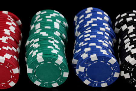 Casino chips isolated on black photo