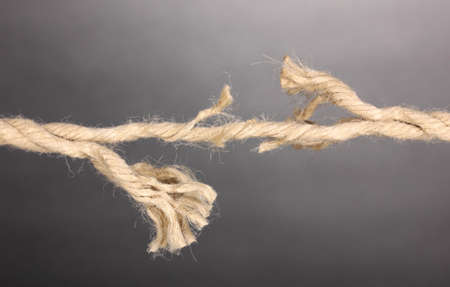Breaking rope on grey background photo