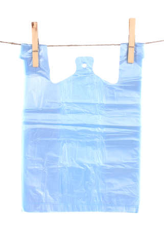 Cellophane bag hanging on rope isolated on white photo