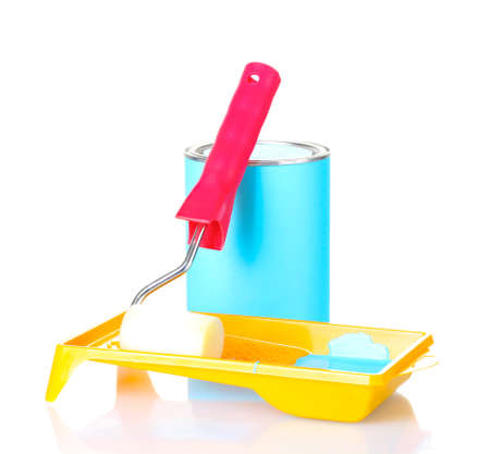 Can of paint with paint roller and tray with blue paint isolated on white photo