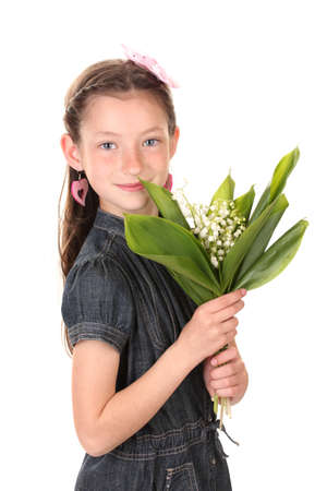 Portrait of beautiful little girl with lilies of the valley isolated on white photo