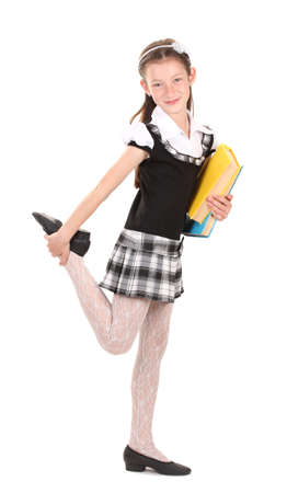 beautiful little girl in school uniform with books isolated on white photo