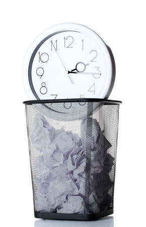 Wall Clock and paper in metal trash bin isolated on white photo