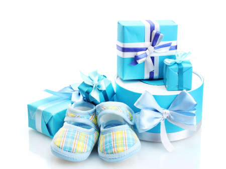 beautiful gifts and baby's bootees isolated on white Stock Photo - 13520988