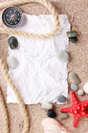 Blank paper on sand beach with seashells and starfishes Stock Photo - 13518972