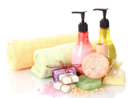 oil massage: Bottles, soaps, sea salt and towels isolated on white