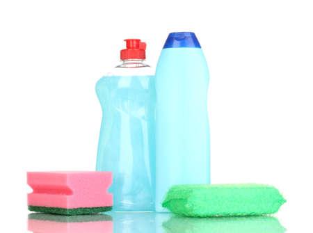 Dishwashing liquids and sponge isolated on white photo