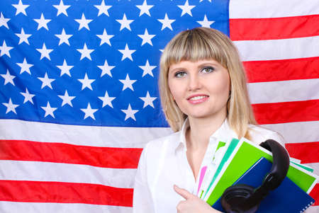 Young woman on the background of the flag of America Stock Photo - 15741436