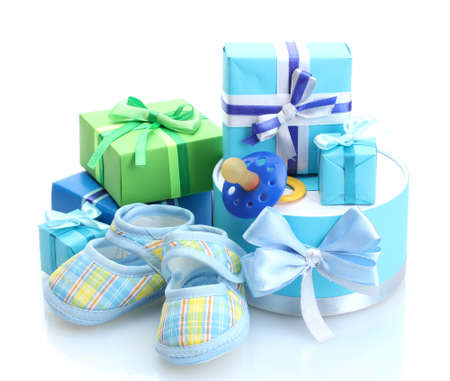 beautiful gifts, baby's bootees and dummy isolated on white photo