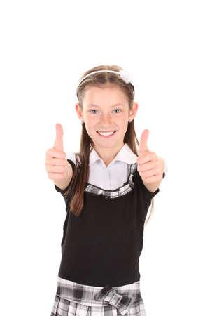 schooler: beautiful little girl in school uniform isolated on white