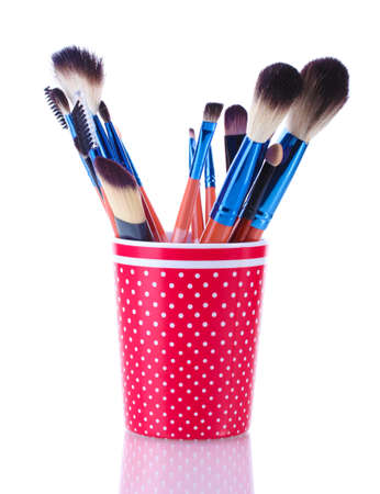 make-up brushes in red cup isolated on white Stock Photo - 13519308