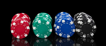 Casino chips isolated on black Stock Photo - 13519299