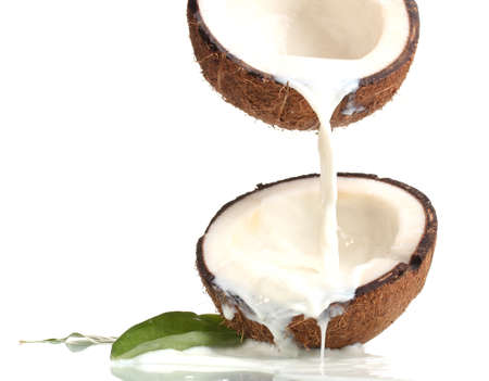 coconut milk: Coconut with coconut milk isolated on white Stock Photo